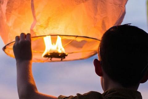 boy holding lantern cropped image