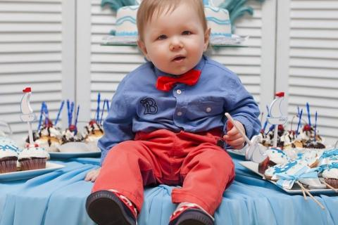 Baby on birthday table