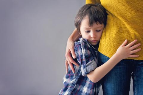 Boy hugging his mum