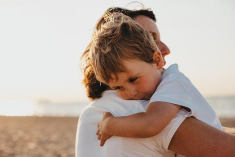 Boy and woman hugging