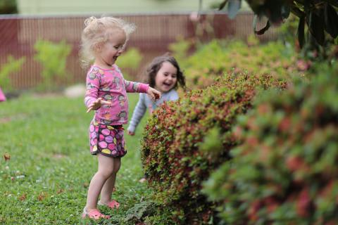 Little girls in the garden by Parker Knight