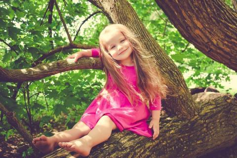 Happy girl in tree