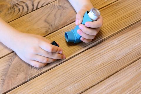 Child holding inhaler