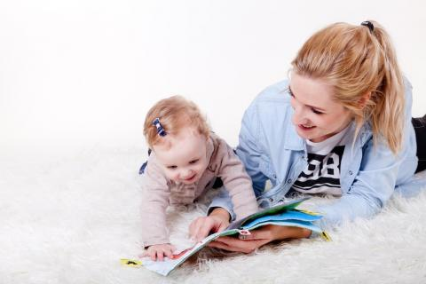 Mother reading to child for National Storytelling Week 2018