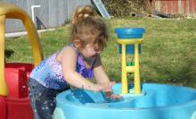 Girl plays with water. Pic by ECraig4