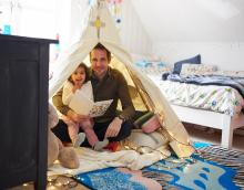 Father and child in an indoor den