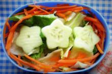 A healthy salad in lunchbox by AJ Gazmen
