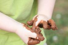 Child's muddy hands