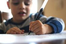 Boy writing with left hand