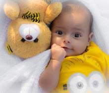 Teddy bear and baby