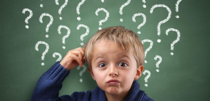 Boy scratching his head because of too many questions