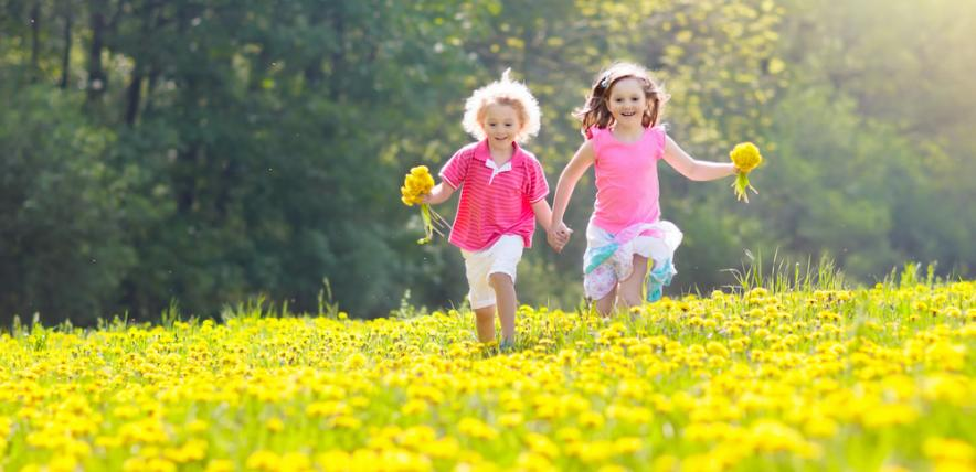 Children running through wildflowers