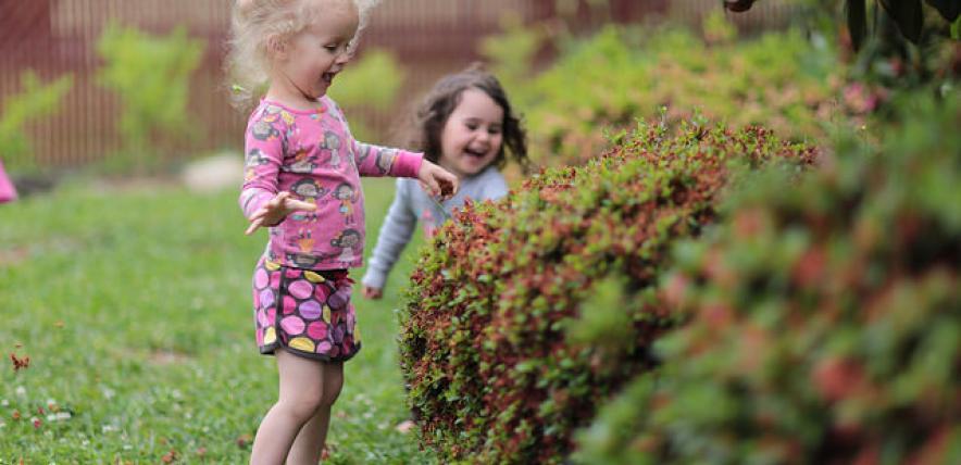 Little girls in the garden by Parker Knight