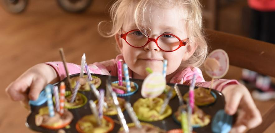Girl in glasses offering buns
