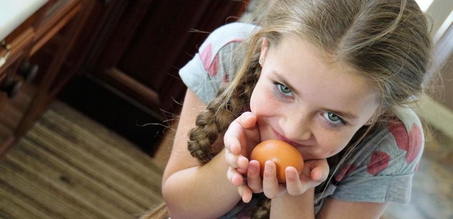 Girl holding egg